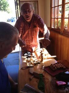 "Peyresourde pass cafe proprietor showing us his ""casse têtes""-- brain teaser games..."