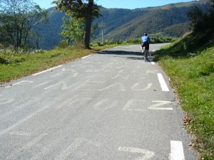 Encouragement for the pros is still visible as the amateurs ride by